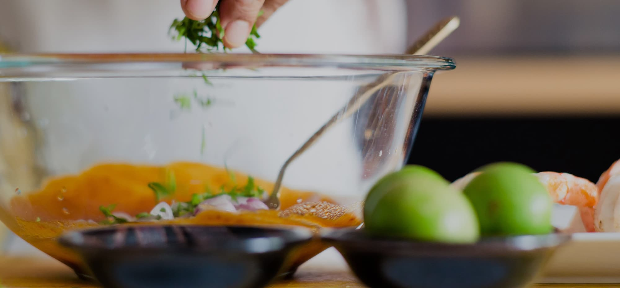 Image of a person adding fresh herbs to a bowl