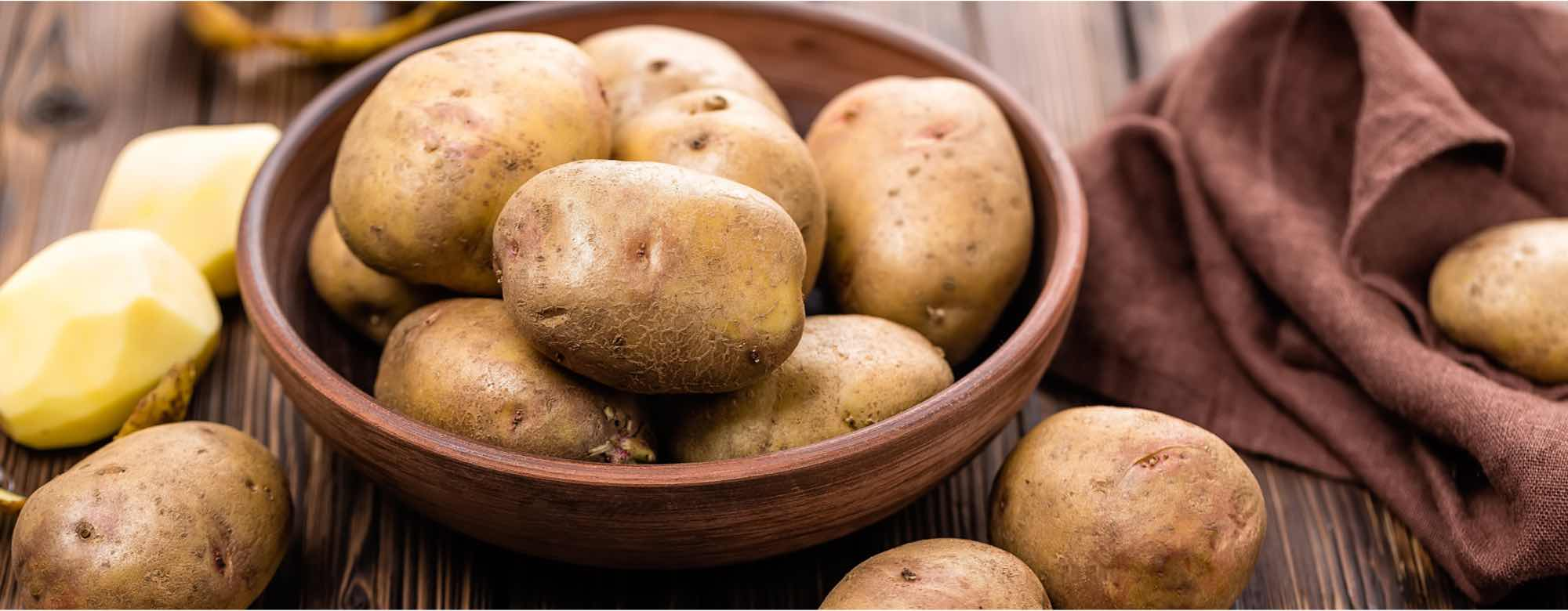 Image of raw potatoes in a bowl
